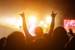 Silhouette of a man at a summer concert stock photo