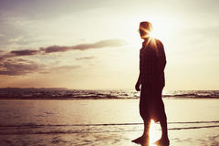 Silhouette of a man  at sunrise on the sea Royalty Free Stock Photos