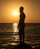 Silhouette of man in sunset Stock Photos
