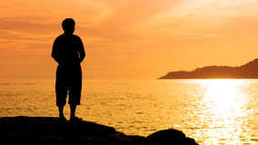Silhouette man at sunset Stock Image