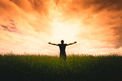 Silhouette of man and sunshine Stock Images