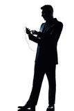 Silhouette man text telephone listening to Stock Photo