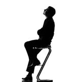 Silhouette man thinking pensive length looking up Royalty Free Stock Images