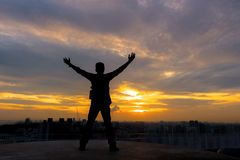 Silhouette of man to see view the landscape sunset on office bui. Lding Stock Image
