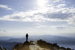 Silhouette of man on top New Hampshire's Mt Washington. Stock Photo