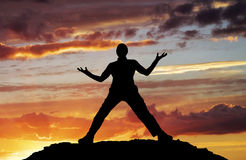 Silhouette of man on top Stock Photo
