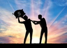Silhouette of a man trying to take from another man a piggy bank. The concept of greed and selfishness. Silhouette of a man trying to take from another man a Stock Photography