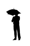 Silhouette of a man with an umbrella Royalty Free Stock Photography