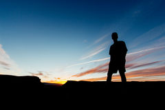 Silhouette of Man Under Blue Sunny Sky at Daytime Royalty Free Stock Photo