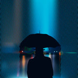 Silhouette of the man under umbrella Royalty Free Stock Image