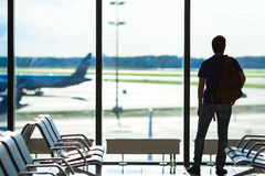Silhouette of a man waiting to board a flight in Stock Photo