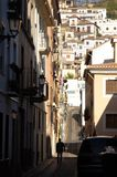 Silhouette of man walking along Granada street royalty free stock photo