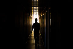 Silhouette. Of a man walking in the corridor Royalty Free Stock Photography