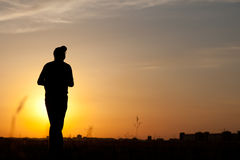 Silhouette of a man walking Royalty Free Stock Images