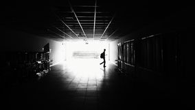 Silhouette of Man Walking on Hall Stock Images