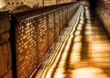 Silhouette of a man walking at night on the bridge. Silhouette of a man walking at night on the bridge Stock Photos