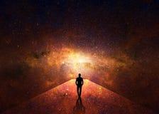 Silhouette of man walking through a passageway through the universe. Silhouette of man walking through a passageway through the red universe Stock Photos