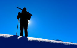 Silhouette of the man walking on snow. Enjoyable nature royalty free stock photo