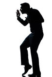 Silhouette man walking tiptoe quietly full length Stock Image