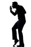 Silhouette man walking tiptoe quietly full length stock image