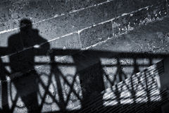 Silhouette of a man on a wall Royalty Free Stock Photo