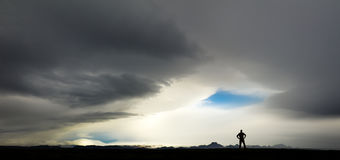 Silhouette of man watching huge storm and clouds in Iceland Royalty Free Stock Image