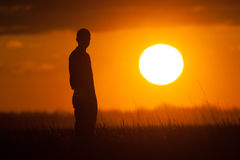 Silhouette of a Man Watching the Sunset Royalty Free Stock Photography