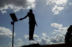 Ascending. Silhouette of a man who seems to be ascending to the heavens Stock Photo
