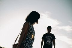 Silhouette of Man and Woman stock photo