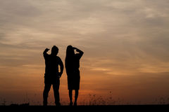 Silhouette man and woman with beautiful the sky at sunset.Backg Royalty Free Stock Photos