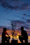 Silhouette man and woman eating each others marshmallows Royalty Free Stock Photo