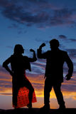 Silhouette man woman facing each other both flex one arm Stock Images