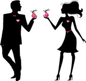 Silhouette of man and woman with perfumes Stock Photography