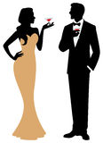 Silhouette of man and woman standing in full length holding a co Royalty Free Stock Image