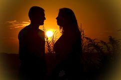 Silhouette of Man and Woman during Sunset Royalty Free Stock Image