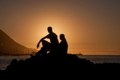 Silhouette of man and women against sunset Stock Photography