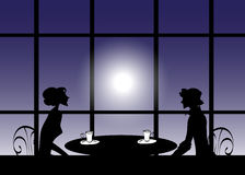 Silhouette Of A Man And A Women At A Table Stock Photography