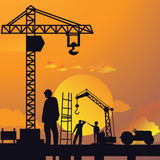 Silhouette of man working on construction site with crane and building in sunset sky dramatic illustration Stock Photos