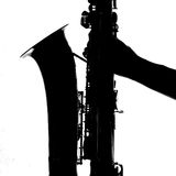 Silhouette of a man's hand  holding a saxophone Royalty Free Stock Photo