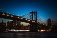 Silhouette of Manhattan Bridge at night Stock Images