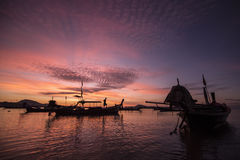 Silhouette of many boat and man on sea of Thailand in sunrise. Silhouette of many boat and man on sea of Thailand Stock Photography