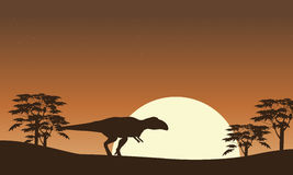 Silhouette of mapusaurus with tree scenery Stock Photos