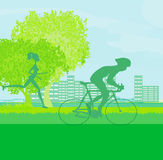 Silhouette of marathon runner and cyclist race Stock Photos