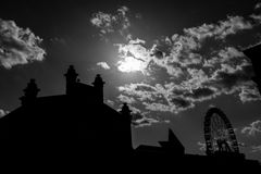 Silhouette of Matadero building and giant ferris wheel in Madrid Royalty Free Stock Image