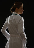 Silhouette of medical doctor woman. Looking on copy space Stock Image