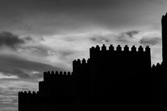 Silhouette of the medieval Wall of Avila Stock Images