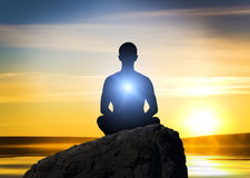 Silhouette of the meditating person Royalty Free Stock Image