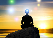 Silhouette of the meditating person Stock Photography