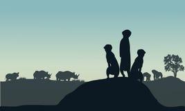 Silhouette of meerkat and rhino Stock Photo