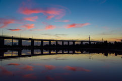 Silhouette of Melbourne's West Gate Bridge at dusk Stock Photo